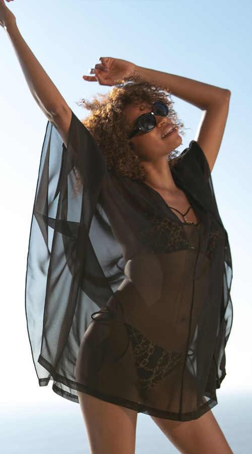Černé průsvitné lehounké šaty přes plavky